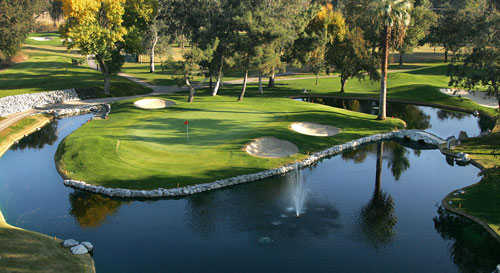 A view of a green surrounded by water at Kings Country Club