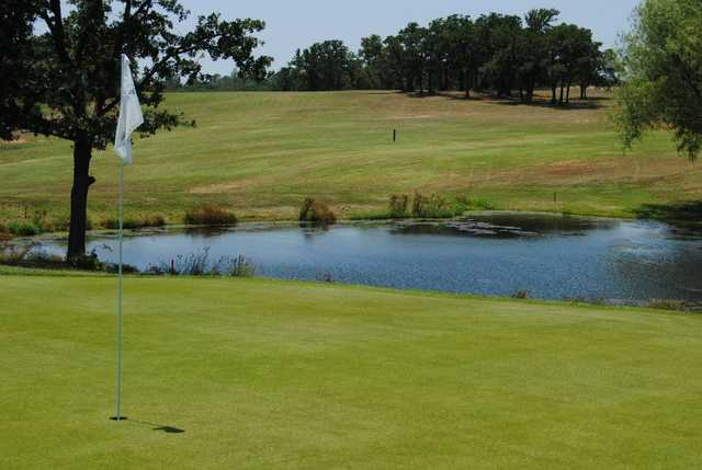 A view of a green with water coming into play at Top O' The Lake Country Club