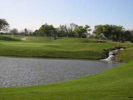A view over the water of a green at Harbor Lakes Golf Club