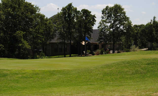 A view of a hole with the clubhouse in background at Top O' The Lake Country Club
