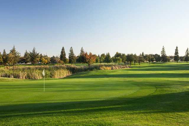 A fall view of a green at Creekside Golf Course