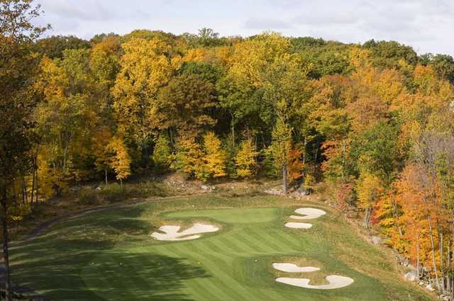 A fall view of hole #6 protected by a collection of undulating bunkers at Patriot Hills Golf Club