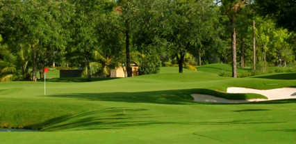 A view of a green protected by bunkers at Adios Golf Club