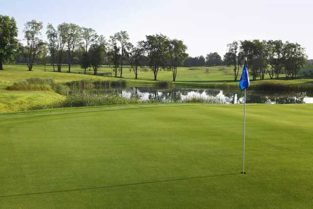 A view of a green with water coming into play at Legacy Hills Golf Club