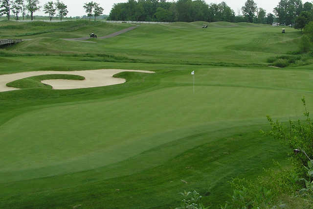 A view of a hole with an undulating bunker on the left side at Bear Slide Golf Club