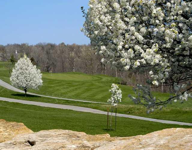 A splendid spring view of green #13 at Teetering Rocks Links