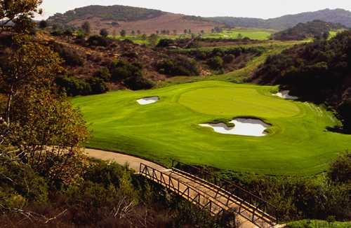 A view of a green guarded by tricky sand traps at Shady Canyon Golf Club