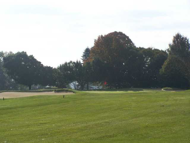 A view of the 6th hole flanked by sand traps at Armitage Golf Course