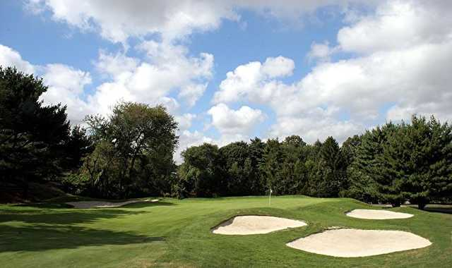 A view of a green protected by sand traps at Garden City Country Club