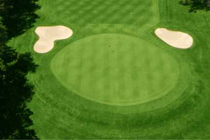 A view of a green protected by bunkers at Allendale Country Club