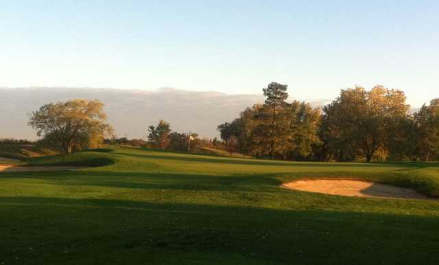 A view of a hole protected by sand traps at Trafalgar Golf and Country Club