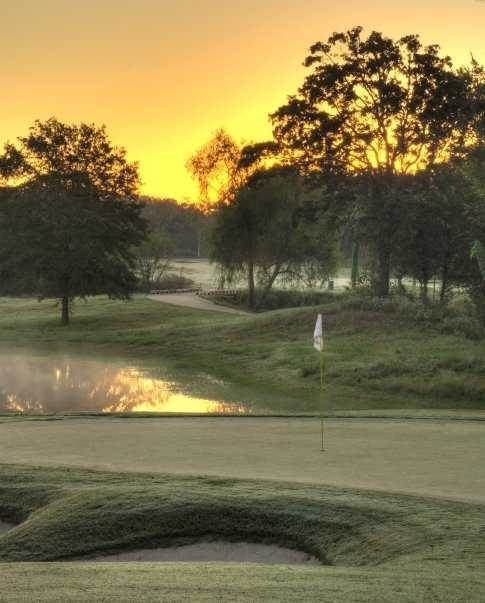 Sunset view of the 16th green at Traditions Club