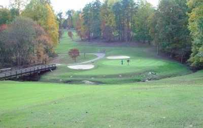 A view of a green protected by bunkers at Winston Lake Golf Course