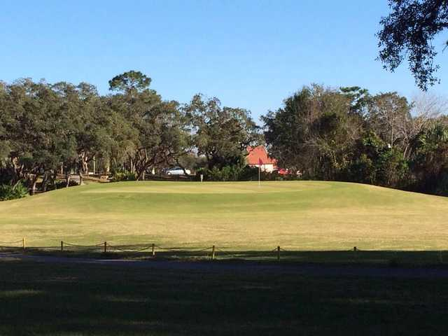 A sunny day view of a hole at Heather Golf & Country Club
