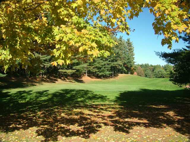 A fall foliage view of hole #8 at Cedar Knob Golf Course