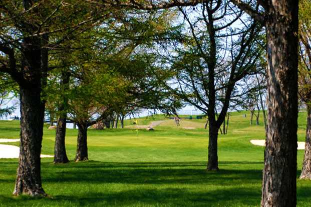 A view of a hole protected by tricky bunkers at Island's End Golf & Country Club