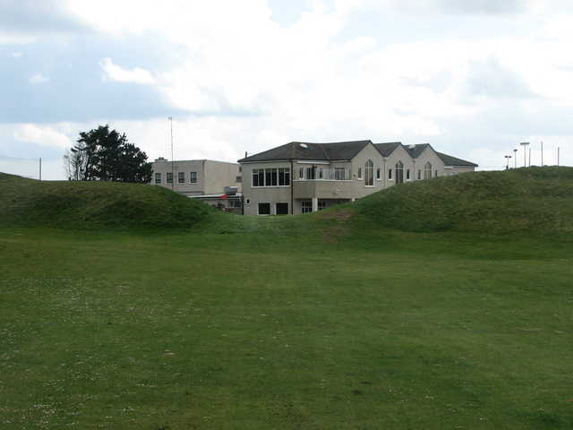 A view of the 17th hole with clubhouse in background at Laytown and Bettystown Golf Club