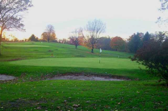 A view of green #5 protected by bunkers at Harmony Ridge Golf Club