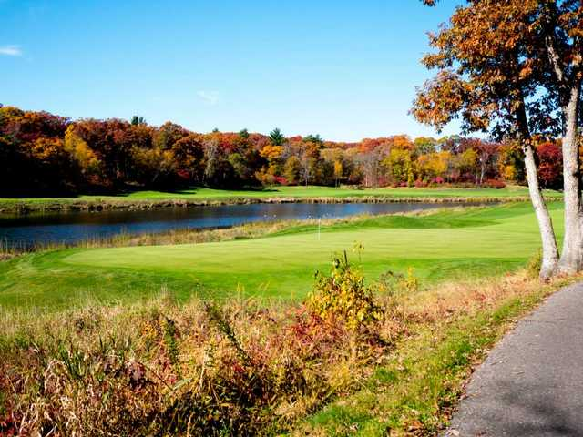 A fall view of a green with water coming into play at Trappers Turn Golf Club