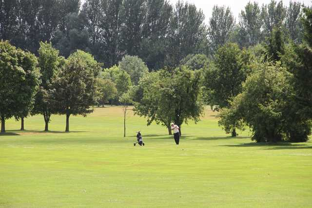 A sunny day view of a fairway at Cheshunt Park Golf Centre