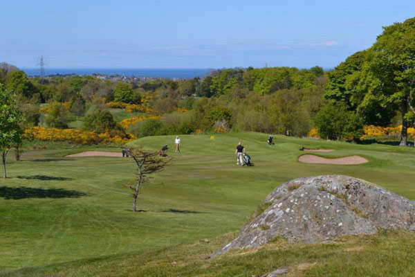 A view of a green protected by bunkers at Clandeboye Golf Club
