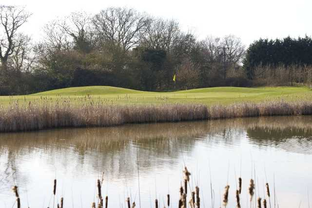 Inviting water protecting the 13th green from Nazeing Golf Club