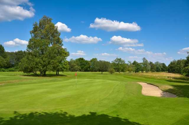 The 8th green and bunker at Chippenham Golf Club