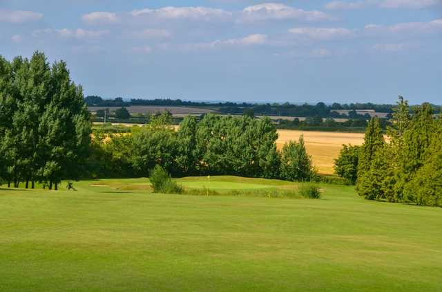 Scenic view of the 17th hole and surrounding countryside at Chippenham Golf Club