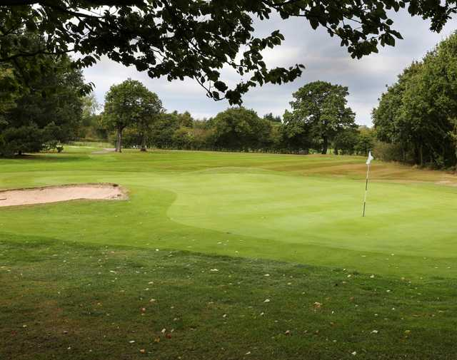 The 8th green and bunker at Helsby Golf Club