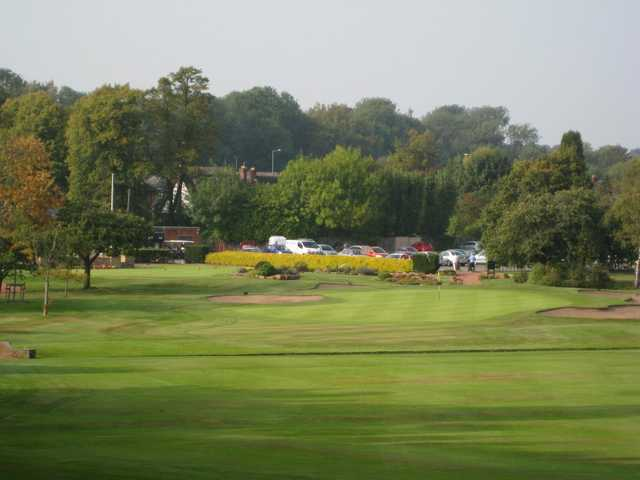 Scenic view of the 18th green and surrounding bunkers at Walsall Golf Club