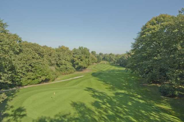 Manicured greens and tree lined fairways as seen at the 5th hole at Silvermere.