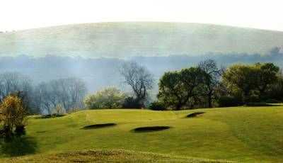 The multiple bunker defended 18th hole at Pyecombe