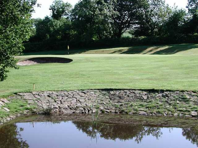 A view of the green from the water hazard