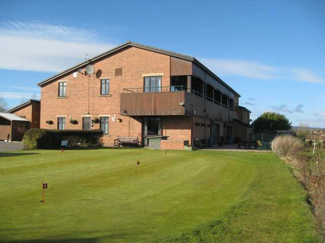 The large clubhouse and putting green at Great Lever and Farnworth Golf Club