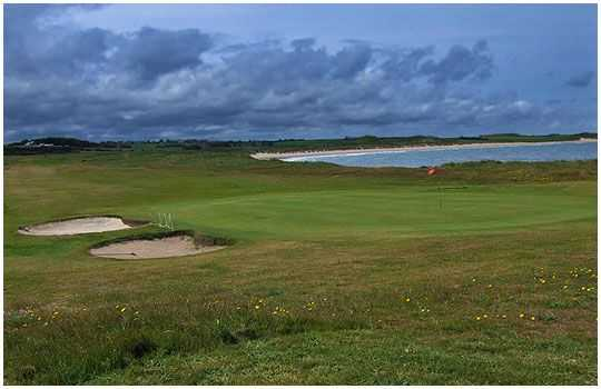 A greenside view of the coast on the Dunstanburgh Castle Golf Course