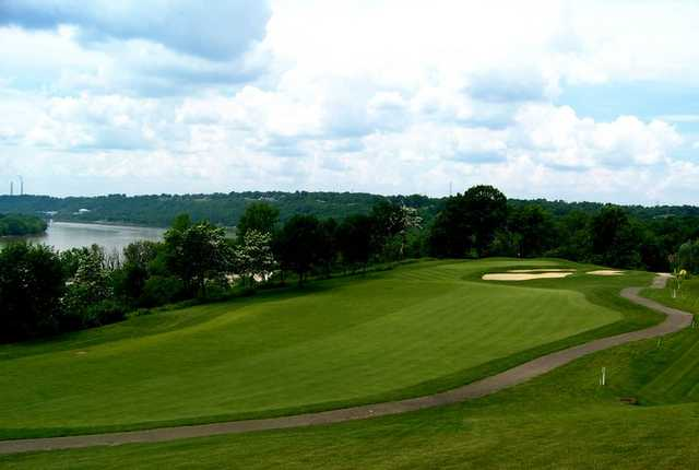 A view of a green with a narrow path on the right at Aston Oaks Golf Club