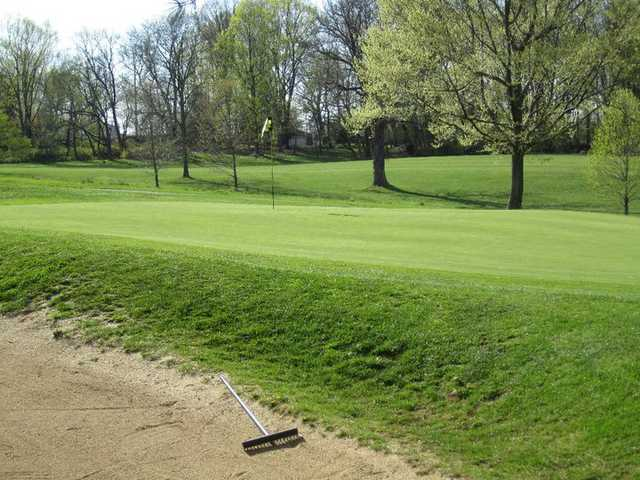 A view of the 10th green guarded by bunkers on both sides at  Middletown Country Club