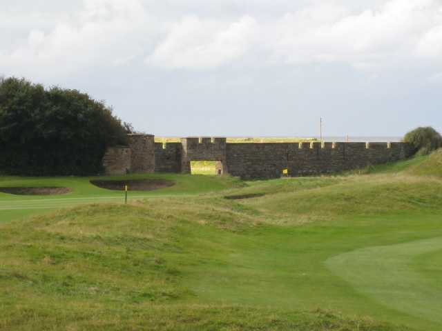The 1st green at Leasowe with the castle wall as backdrop