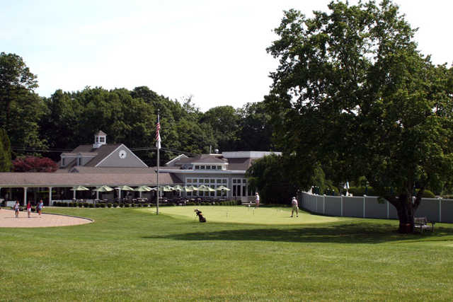 A view of the practice area and the clubhouse at Country Club of New Canaan