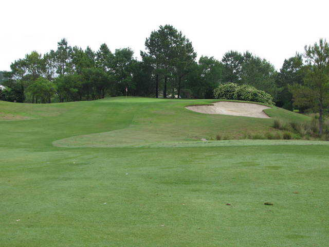View of a green and bunker at Crescent Pointe Golf Club