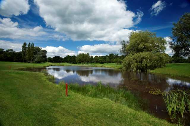 Scenic view across the pond of the 9th hole at Tytherginton Golf Club
