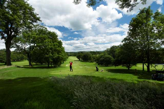View down the tree lined fairway of the 12th at Tytherginton Golf Club