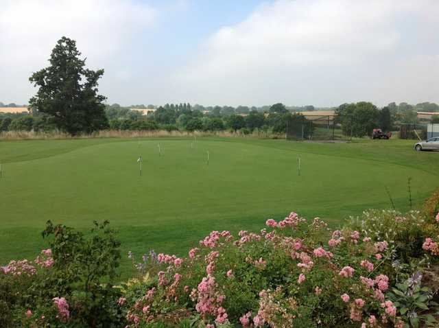 A view of the putting green and surrounding countryside at Windmill Village Golf Club