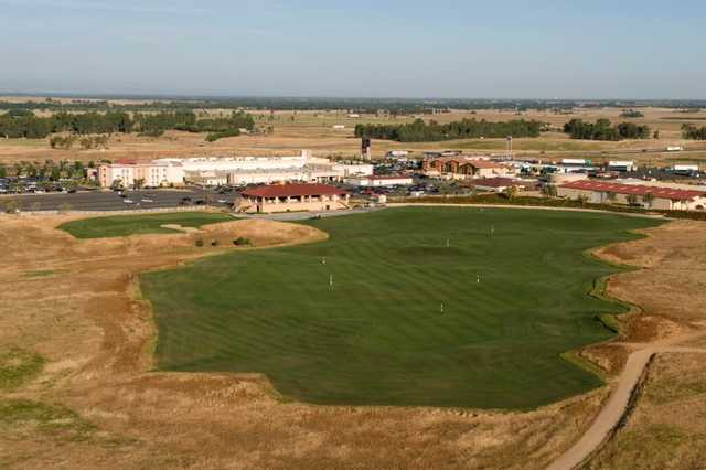 A view of the driving range at Sevillano Links with clubhouse in background