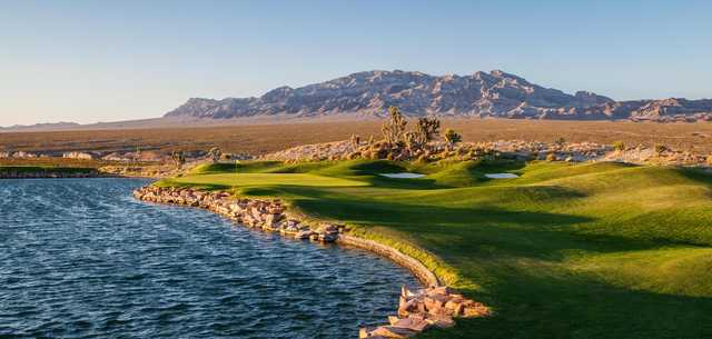 With a spectacular view of Sheep Mountain, the par-3 16th at Snow Mountain requires a long carry over water.