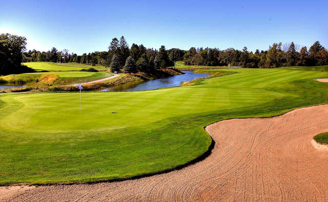 A view of the 14th green with water coming into play at Pine Meadow Golf Club