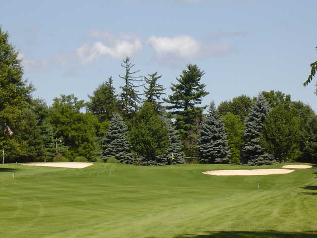 A view of the 9th green protected by bunkers at Trumansburg Golf Club