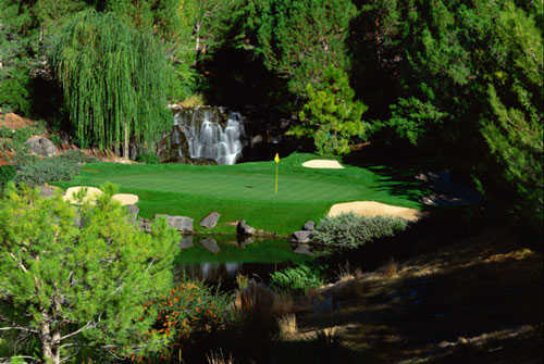 A view of the 17th green with water coming into play at Shadow Creek Golf Course