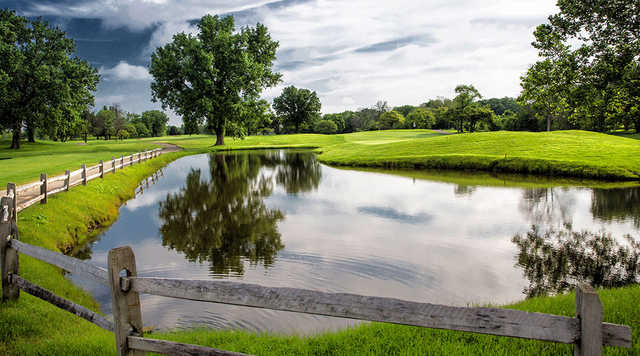 A view over the water of hole #11 from Course #1 at Cog Hill Golf and Country Club.