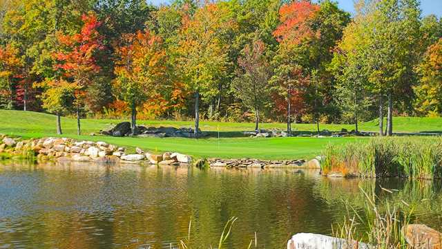 A fall day view of a green at Nemacolin Woodlands Resort